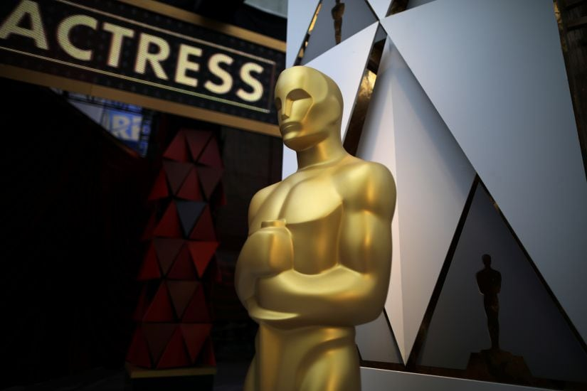 An Oscar statue is seen outside the Dolby Theatre during preparations for the Oscars in Hollywood, Los Angeles, California, U.S. March 3, 2018. REUTERS/Lucy Nicholson - RC11AD225550
