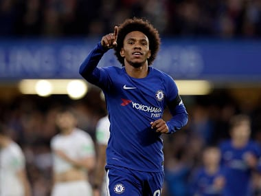 Chelsea's Willian celebrates after scoring the opening goal during the English Premier League soccer match between Chelsea and Crystal Palace at Stamford Bridge stadium in London, Saturday, March 10, 2018. (AP Photo/Matt Dunham)