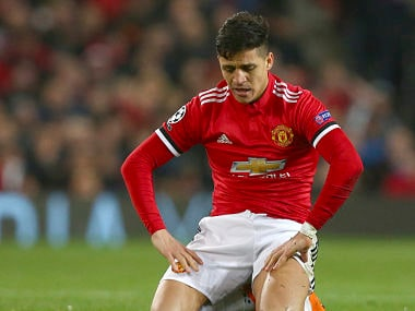 Manchester United's Alexis Sanchez, reacts after United miss a chance to score during the Champions League round of 16 second leg soccer match between Manchester United and Sevilla, at Old Trafford in Manchester, England, Tuesday, March 13, 2018. Sevilla won the game 2-1 and go through to the quarterfinals . (AP Photo/Dave Thompson)