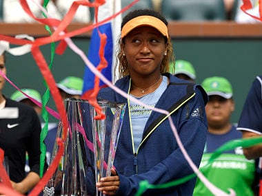 Naomi Osaka, of Japan, poses with her trophy as streamers fall after defeating Daria Kasatkina, of Russia, in the women's final at the BNP Paribas Open tennis tournament, Sunday, March 18, 2018, in Indian Wells, Calif. Osaka won 6-3, 6-2. (AP Photo/Mark J. Terrill)