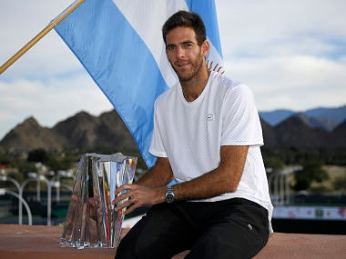 Juan Martin del Potro, of Argentina, poses with his trophy after defeating Roger Federer, of Switzerland, during the men's final at the BNP Paribas Open tennis tournament, Sunday, March 18, 2018, in Indian Wells, Calif. Del Potro won 6-4, 6-7 (8), 7-6 (2). (AP Photo/Mark J. Terrill)
