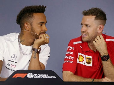 Mercedes driver Lewis Hamilton of Britain and Ferrari driver Sebastian Vettel of Germany, right, look at each other during a drivers' press conference at the Australian Formula One Grand Prix in Melbourne, Thursday, March 22, 2018. The first race of the 2018 seasons is on Sunday. (AP Photo/Rick Rycroft)