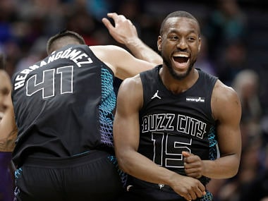 Charlotte Hornets' Kemba Walker (15) celebrates with Willy Hernangomez (41) during the second half of an NBA basketball game against the Memphis Grizzlies in Charlotte, N.C., Thursday, March 22, 2018. (AP Photo/Chuck Burton)