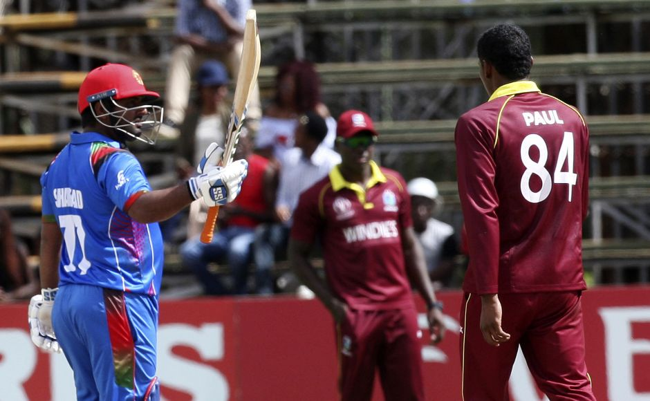 Afghanistan batsman Mohammad Shahzad celebrates after scoring 50 runs during their cricket world cup qualifier match against West Indies at Harare. AP