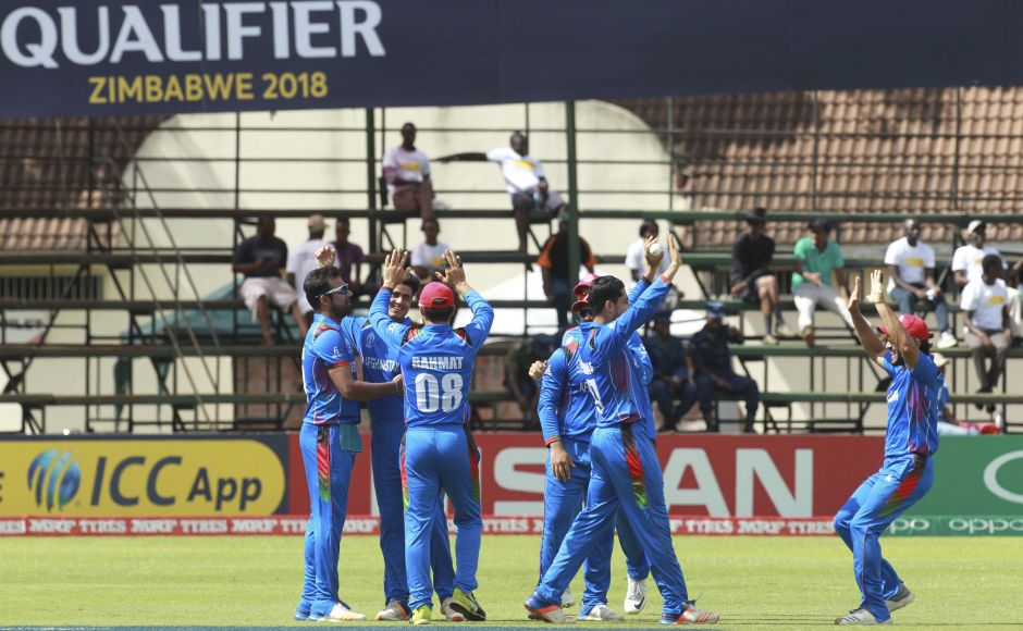 Afghanistan players celebrate the early wicket of West Indies batsman Chris Gayle during their Cricket World Cup qualifier at Harare. AP