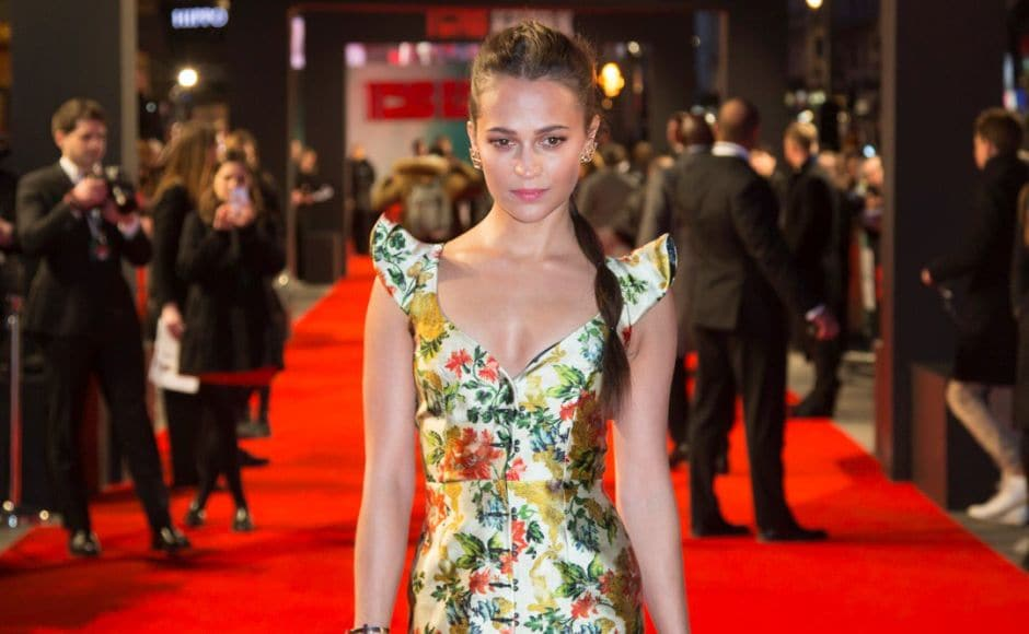 Alicia Vikander poses for photographers upon arrival at the premiere of the film Tomb Raider in London. Image via Twitter