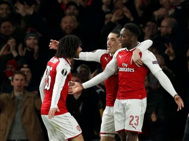 Arsenal's Danny Welbeck celebrates scoring their third goal with teammates. Reuters