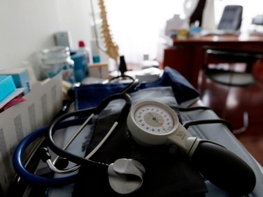 A photo illustration shows a stethoscope and blood-pressure machine. Image: Reuters