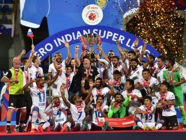 Chennaiyin FC celebrate after winning against Bengaluru FC during the ISL final match. PTI