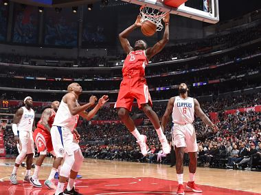 Houston Rockets' Clint Capela dunks the ball as Los Angeles Clippers' players look on. Image courtesy: Twitter @NBA