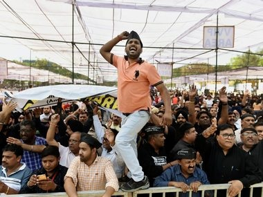Traders raise slogans during a protest at Ramlila Ground in New Delhi, on Wednesday. Markets remain shut as traders, employees, and business owners stage a mega rally against the ongoing sealing drive. PTI