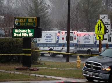 Deputies, federal agents and rescue personnel, converge on Great Mills High School, the scene of the shooting. AP