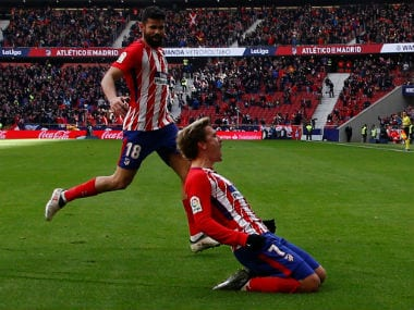 Atletico Madrid's Antoine Griezmann celebrates scoring their first goal with Diego Costa. Reuters