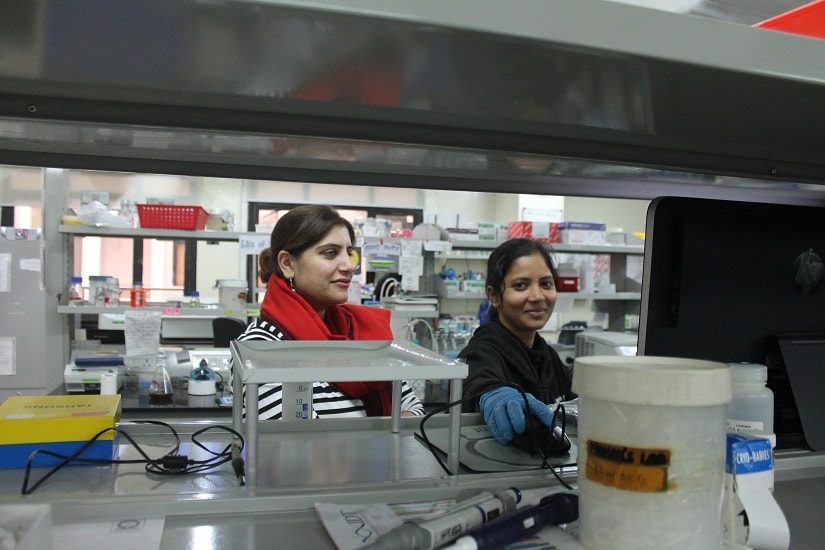 Mahak with a PhD student at her lab