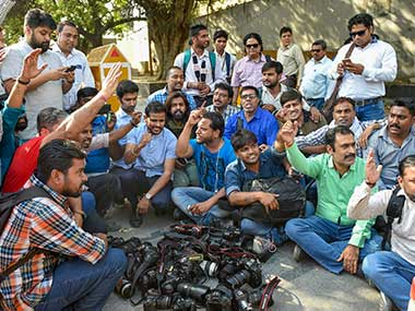 Photojournalists from various organization protest outside the police headquarters against alleged manhandling of two female journalists by the Delhi Police, in New Delhi. PTI