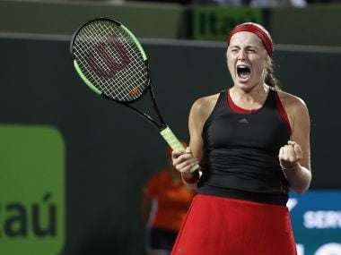Jelena Ostapenko celebrates after winning match point against Danielle Collins. Reuters