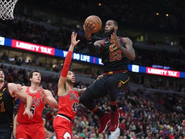 LeBron James (23) shoots over Chicago Bulls forward Denzel Valentine (45) during their game. Reuters
