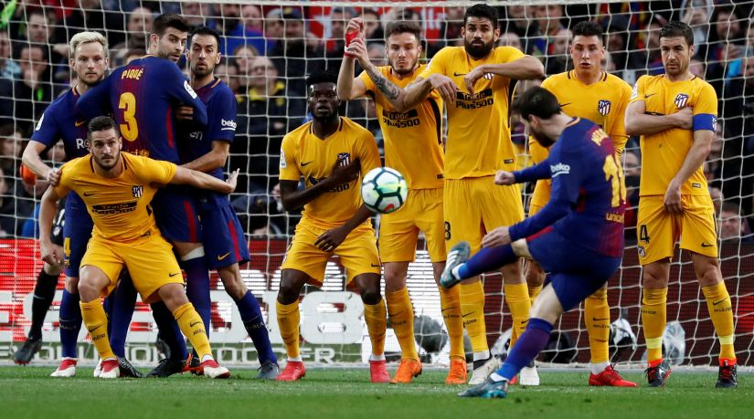 Barcelona's Lionel Messi scores their only goal against Atletico Madrid from a free-kick. Reuters