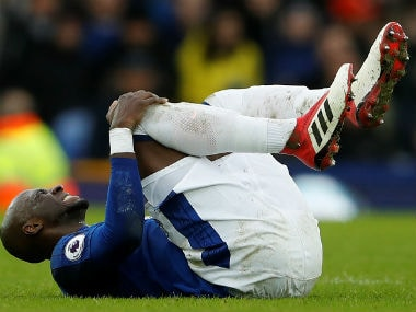 Everton's Eliaquim Mangala cries in pain after sustaining an injury. Reuters