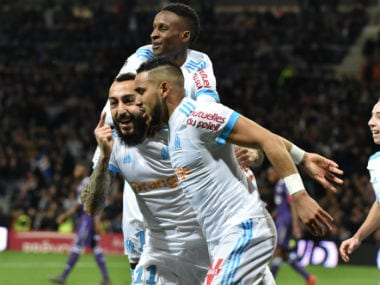 Marseille's Greek forward Konstantinos Mitroglou (L) celebrates with teammates after scoring a decisive goal against Toulouse. AFP
