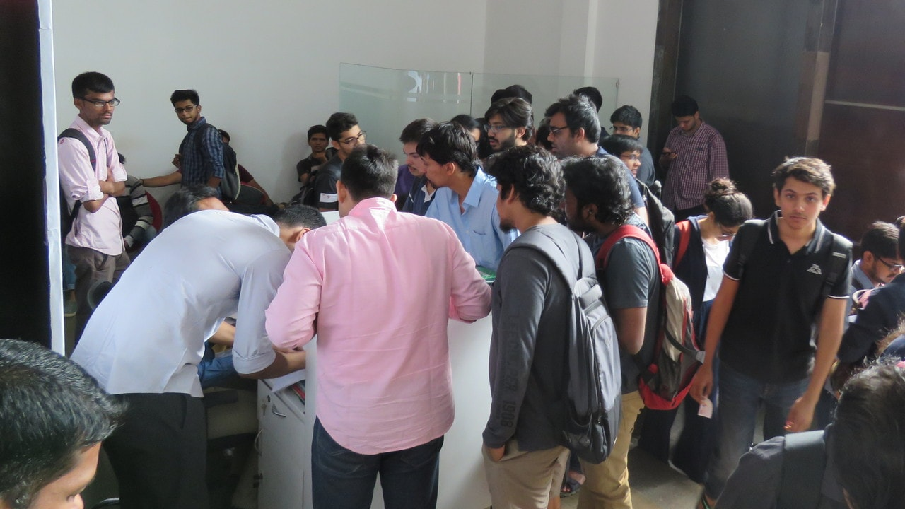 Participants queue for registration ahead of the start of the Hackathon at The Garage