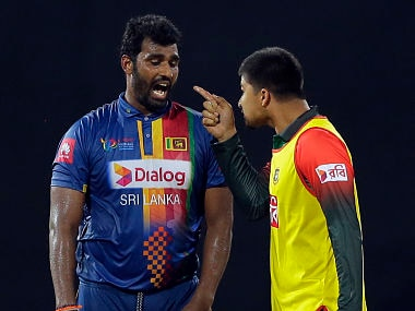 Bangladesh's Nurul Hasan exchanges words with Sri Lanka's skipper Thisara Perera on Friday. AP