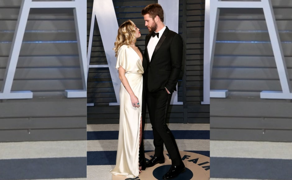 Miley Cyrus and Liam Hemsworth make an appearance together. Image from Twitter/@BritishVogue