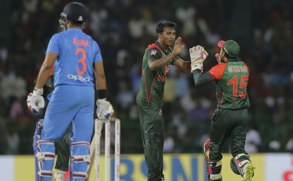 India lost their in-form batsman Shikhar Dhawan cheaply in the chase while Suresh Raina was also dismissed for a duck. AP