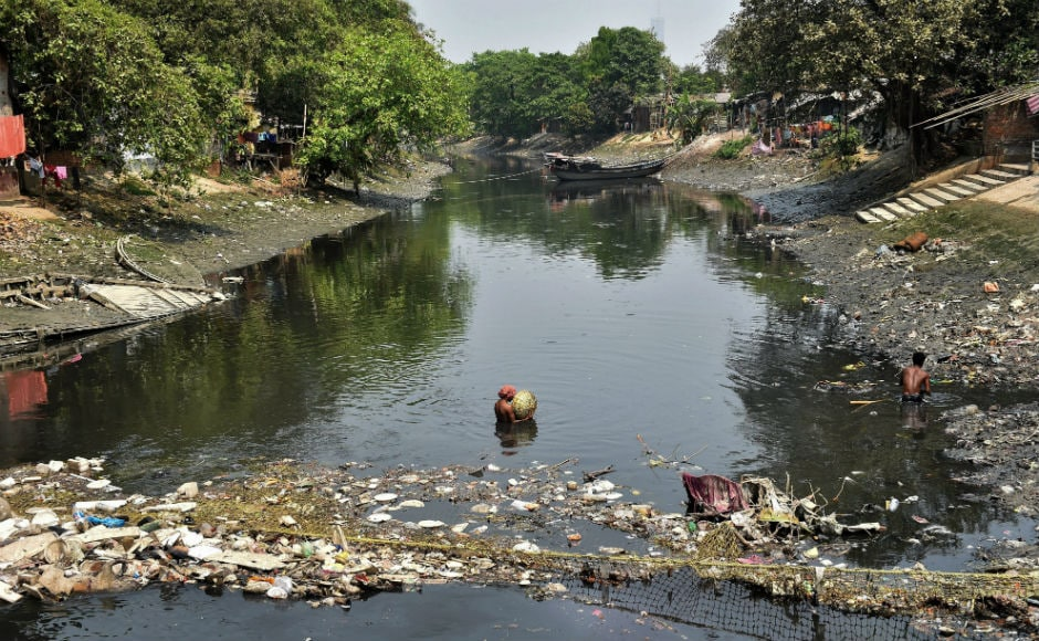 Workers segregating solid waste dumped in Adi Ganga at Kalighat in Kolkata. Prime Minister Narendra Modi on Thursday tweeted the importance of