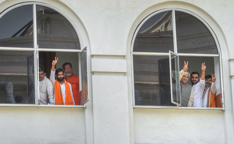 Legislators from Uttar Pradesh flashed victory signs after voting in Uttar Pradesh.While the ruling BJP won nine of the 10 Rajya Sabha seats, the Samajwadi Party's Jaya Bachchan won the ninth seats. PTI