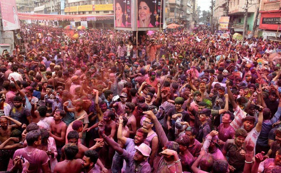 Hundreds of people celebrating Holi in West Bengal's Kolkata town. Children and elders sprayed colour and gulal on each other and later offered sweets. PTI