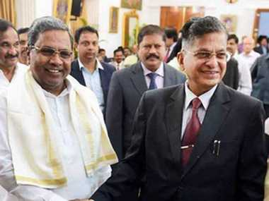 File image of Karnataka chief minister Siddaramaiah greeting Lokayukta Justice P Vishwanath Shetty and his wife during the swearing ceremony at Raj Bhavan in Bengaluru.(Image: PTI )