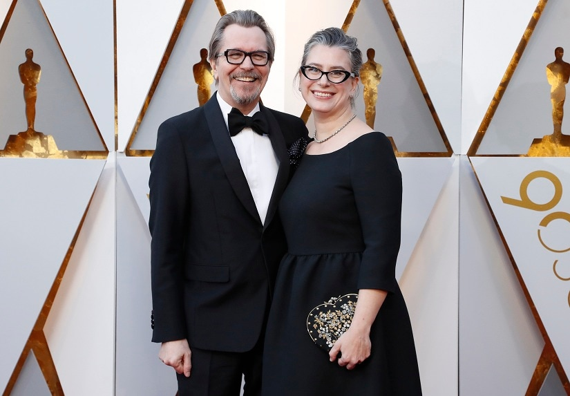 90th Academy Awards - Oscars Arrivals – Hollywood, California, U.S., 04/03/2018 – Gary Oldman and wife Gisele Schmidt. REUTERS/Mario Anzuoni - HP1EE3501SBLE