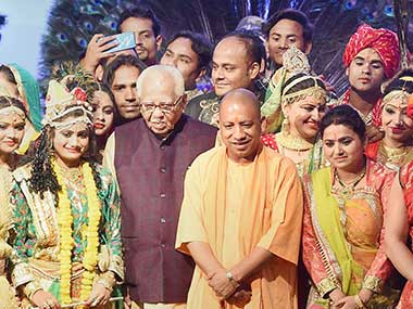 Uttar Pradesh Governor Ram Naik and Chief Minister Yogi Adityanath pose for a photograph with the artists performing at a function on completion of one year of BJP government at Lok Bhawan in Lucknow. PTI