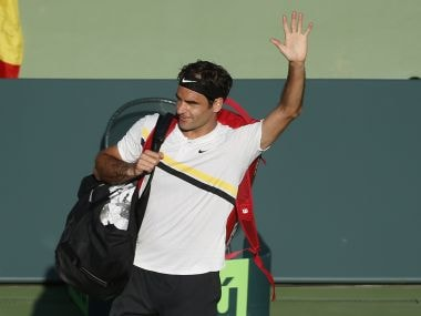 Roger Federer waves to the crowd after his loss to Thanasi Kokkinakis. AP
