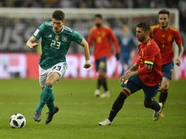 Germany's Mario Gomez runs for the ball beside Spain's Sergio Ramos, right, during their international friendly in Duesseldorf, Germany. AP