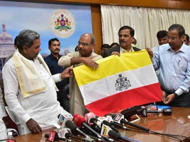 Karnataka CM Siddaramaiah unveils the Karnataka flag on Thursday. Twitter@CMofKarnataka