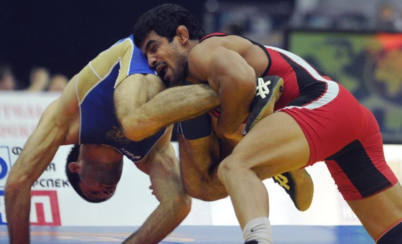 Sushil (red) fights for the gold with Russian Alan Gogaev during the 66 kg freestyle final at the World Wrestling Championships in Moscow on 12 Sept., 2010. AFP