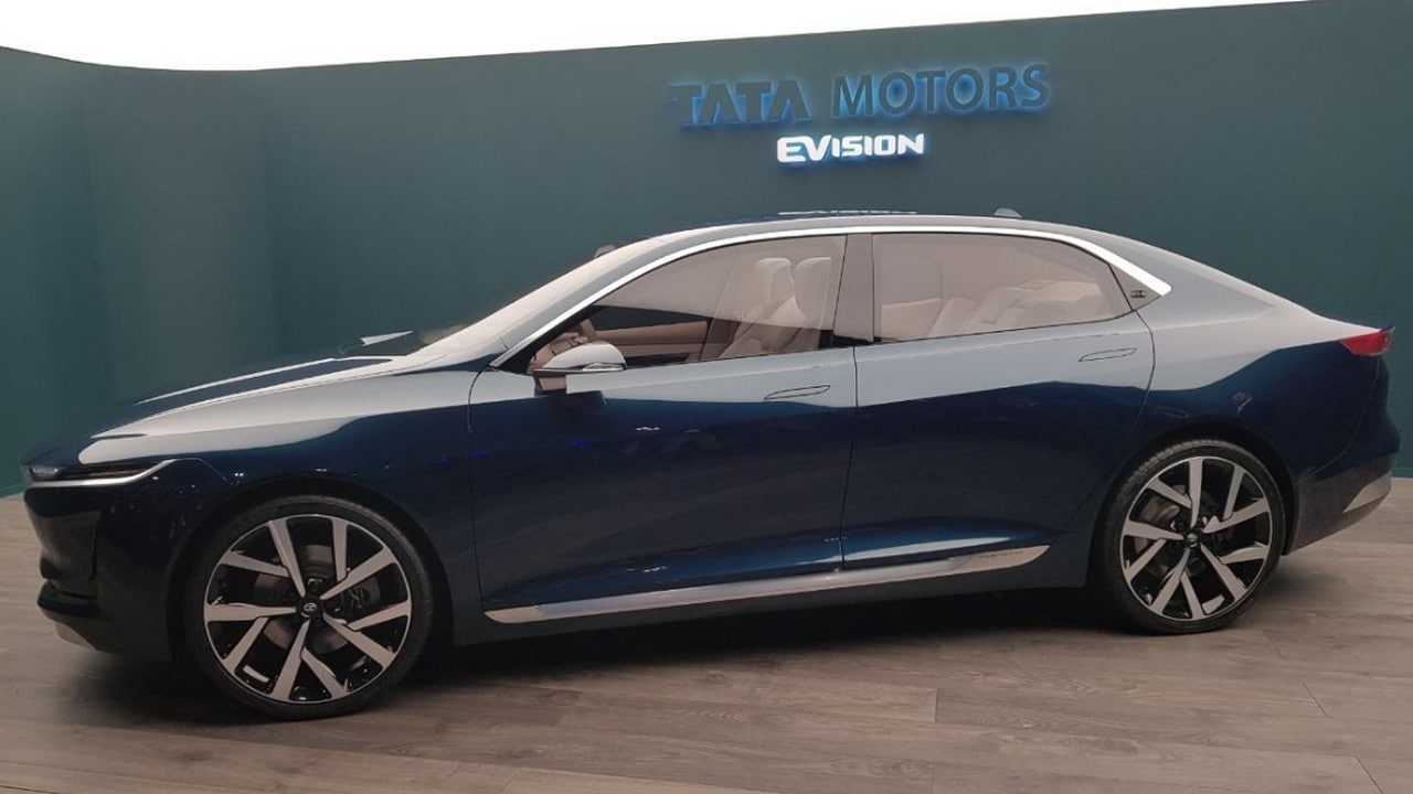 Tata motors unveils futuristic all electric evision for Tata motors electric car