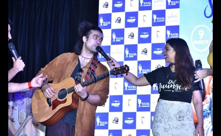 Singer Jubin Nautiyal strums his guitar while singing a song from the film.