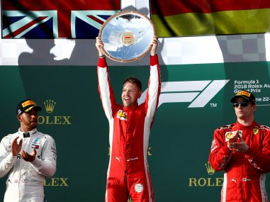 Sebastian Vettel celebrates his win on the podium with Lewis Hamilton and Kimi Raikkonen. Reuters