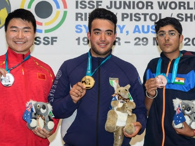 India's Vivaan Kapoor (right) poses with his bronze medal with other winners. Image Courtesy: ISSF