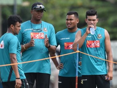 File image of Bangladesh coach Courtney Walsh (2L) chats with Taskin Ahmed (R), Kamrul Islam (L) and Subashis Roy (2R) during a practice session in Colombo. AFP