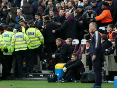 West Ham United fans react as police and stewards look on at the London Stadium. Reuters