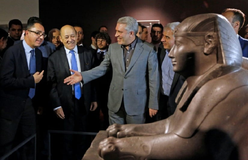 Louvre museum President Jean-Luc Martinez (L), French Foreign Minister Jean-Yves Le Drian (C) and Vice President of Iran Head of Cultural Heritage Ali Asghar Mounesan tour an unprecedented exhibition of artworks from the Louvre in Tehran on March 5, 2018. AFP/Anna Kerare