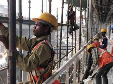Workers at a building being renovated at Bhendi Bazar. Twitter/SBUT_Mumbai