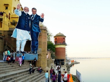 A cutout of Narendra Modi and Emmanuel Macron at Tulsi Ghat in Varanasi. PTI