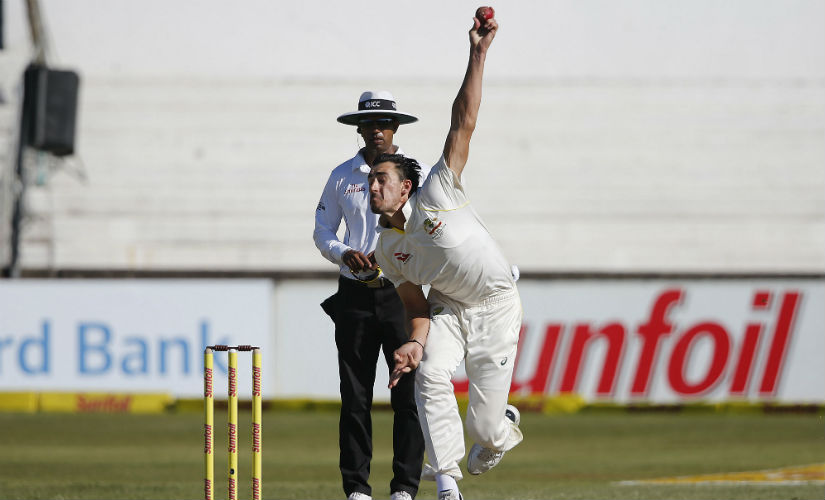 Australia's Mitchell Starc (R) in action during Day 2 of the first Test against South Africa in Durban. AFP