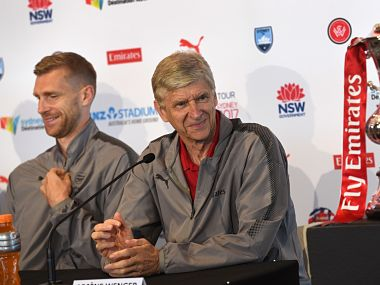 Arsenal football manager Arsene Wenger (R) and player Per Mertesacker (L) listen to a question during a press conference on July 11, 2017, ahead of two pre-season football friendly matches against Sydney FC on July 13 and Western Sydney Wanderers on July 15. / AFP PHOTO / WILLIAM WEST