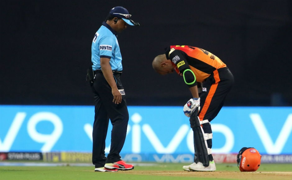 Shikhar Dhawan grimaces after copping a blow to his left knee. Sportzpics